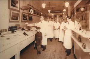 Six men and one boy standing inside the Upper East Side butcher shop