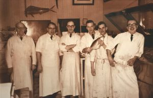 Historic photo of butchers inside a butcher shop large